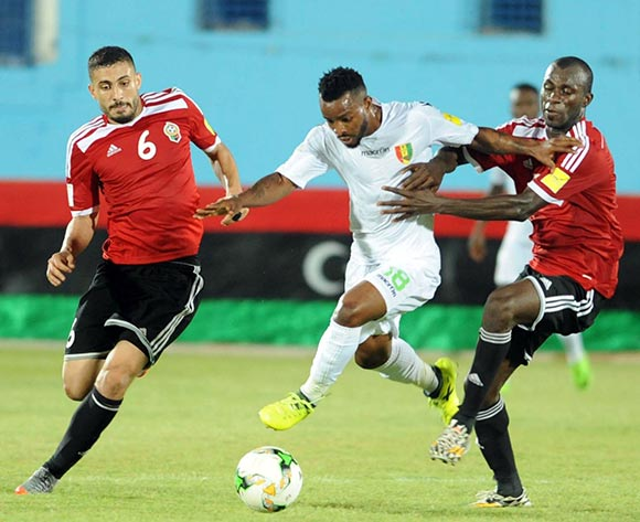 Libya players  Aleyat Mohamed (L)and Ahmed Bader (R)  fights for the ball with Guinea player  Soumah Seydouba (C)  during the World Cup 2018 qualifying football match between Libya and Guinea in Monastir, Tunisia on 04 September 2017 © BackpagePix