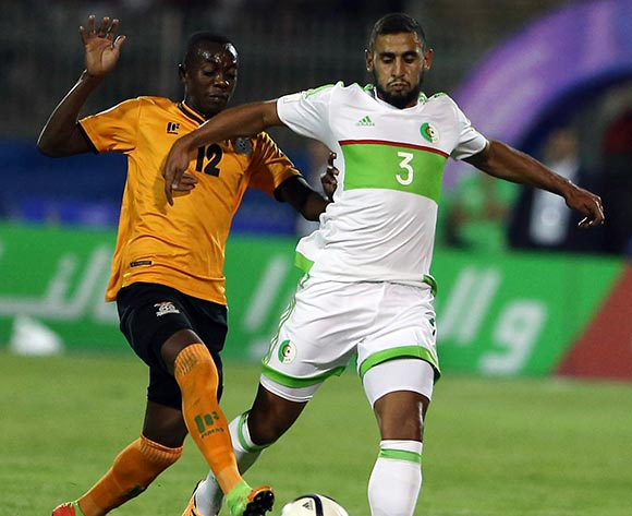 Algerian player  Faouzi Ghoulam (R)  fights for the ball with Zambian player  Justin Shonga (L)  during the World Cup 2018 qualifying football match between Algeria and Zambia in Constantine, Algeria on 05 September 2017 © BackpagePix