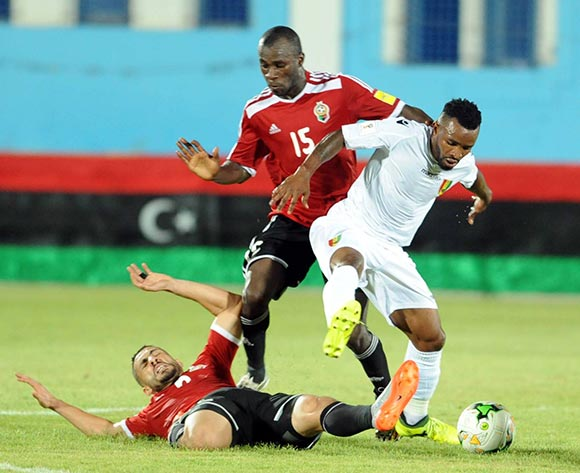 Libya players  Aleyat Mohamed (L) and Ahmed Bader (C)  fights for the ball with Guinea player  Soumah Seydouba (R)  during the World Cup 2018 qualifying football match between Libya and Guinea in Monastir, Tunisia on 04 September 2017 © BackpagePix