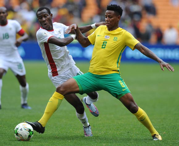 Bongani Zungu of South Africa is challenged by Bayala Cyrille Barros of Burkina Faso 2018 World Cup qualifier football match between South Africa and Burkina Faso on the 7 October 2017 at Soccer City, Johannesburg  © Sydney Mahlangu /BackpagePix