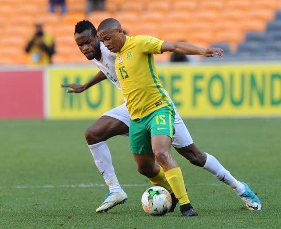 Andile Jali of South Africa is challenged by Quatta Mouhamed of Burkina Faso 2018 World Cup qualifier football match between South Africa and Burkina Faso on the 7 October 2017 at Soccer City, Johannesburg  © Sydney Mahlangu /BackpagePix