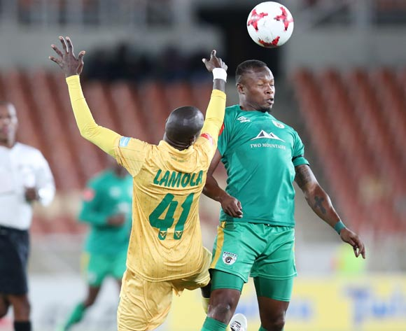Letladi Madubanya of Baroka FC challenged by Lerato Lamola of Golden Arrows during the Absa Premiership 2017/18 match between Baroka FC and Golden Arrows at Peter Mokaba Stadium in Polokwane, South Africa on 17 October 2017 ©Muzi Ntombela/BackpagePix