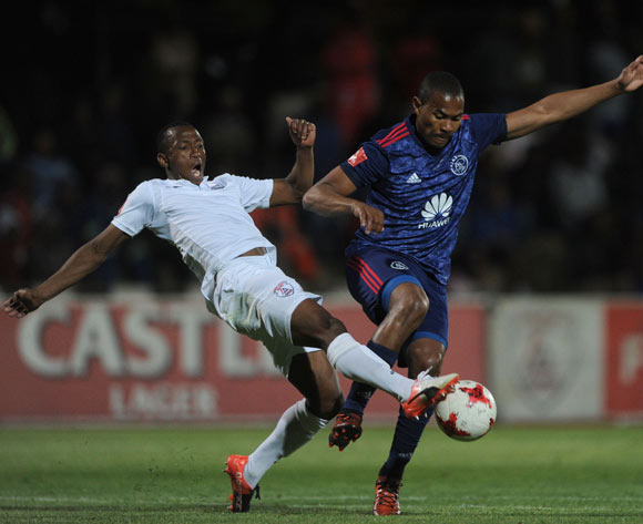 Prince Nxumalo of Ajax Cape Town is tackled by Sifiso Mbhele of Free State Stars during the Absa Premiership 2017/18 match between Free State Stars and Ajax Cape Town  on 18 October 2017 at Goble Park Stadium @Sydney Mahlangu/BackpagePi