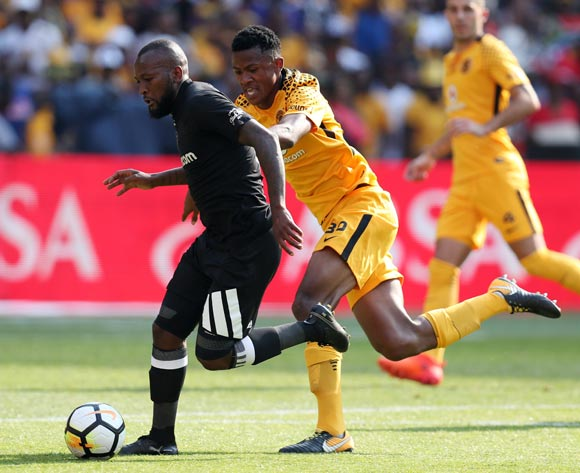 Mpho Makola of Orlando Pirates challenged by Siyabonga Ngezana of Kaizer Chiefs during the Absa Premiership 2017/18 match between Kaizer Chiefs and Orlando Pirates at FNB Stadium in Johannesburg, South Africa on 21 October 2017 ©Muzi Ntombela/BackpagePix