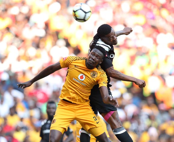 Eric Mathoho of Kaizer Chiefs clears ball from Thamsanqa Gabuza of Orlando Pirates during the Absa Premiership 2017/18 match between Kaizer Chiefs and Orlando Pirates at FNB Stadium in Johannesburg, South Africa on 21 October 2017 ©Muzi Ntombela/BackpagePix