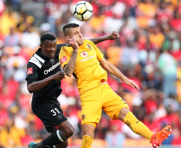 Daniel Cardoso of Kaizer Chiefs clears ball from Thamsanqa Gabuza of Orlando Pirates during the Absa Premiership 2017/18 match between Kaizer Chiefs and Orlando Pirates at FNB Stadium in Johannesburg, South Africa on 21 October 2017 ©Muzi Ntombela/BackpagePix