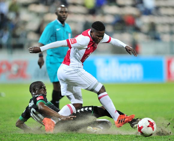 Ndiviwe Mdabuka of Ajax Cape Town is tackled by Ndumiso Mabena of Bloemfontein Celtic during the Absa Premiership 2017/18 game between Ajax Cape Town and Bloemfontein Celtic at Athlone Stadium, Cape Town on 21 October 2017 © Ryan Wilkisky/BackpagePix