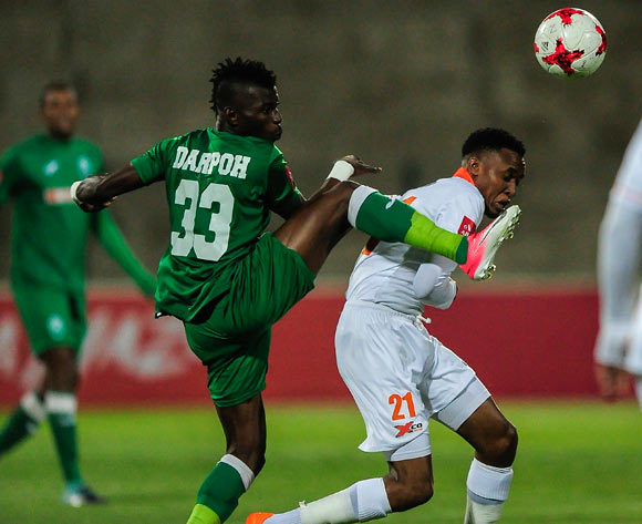 Samuel Mensah Darpoh of AmaZulu FC gets the ball before Sammy Seabi of Polokwane City FC during the Absa Premiership 2017/18 game between AmaZulu and Polokwane City at King Zwelithini Stadium, Durban on 18 October 2017 © Gerhard Duraan/BackpagePix