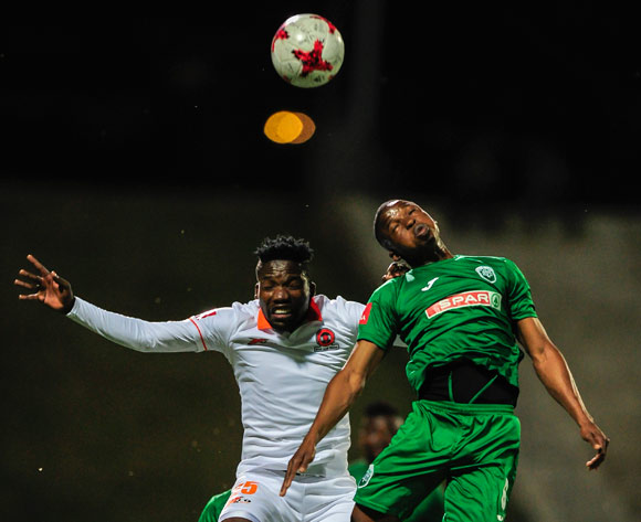 Butholezwe Ncube of AmaZulu FC wins the midair battle against Rending Ndou of Polokawne City FC during the Absa Premiership 2017/18 game between AmaZulu and Polokwane City at King Goodwill Zwelithini Stadium, Durban on 18 October 2017 © Gerhard Duraan/BackpagePix
