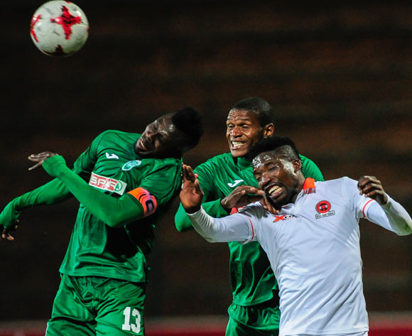 Sadate Ouro-Akoriko (Captain) of AmaZulu FC gets the ball in the air before his team mate Vukile Mngqibisa of AmaZulu FC and Jabulani Maluleke of Polokwane City FC  during the Absa Premiership 2017/18 game between AmaZulu and Polokwane City at King Goodwill Zwelithini Stadium, Durban on 18 October 2017 © Gerhard Duraan/BackpagePix
