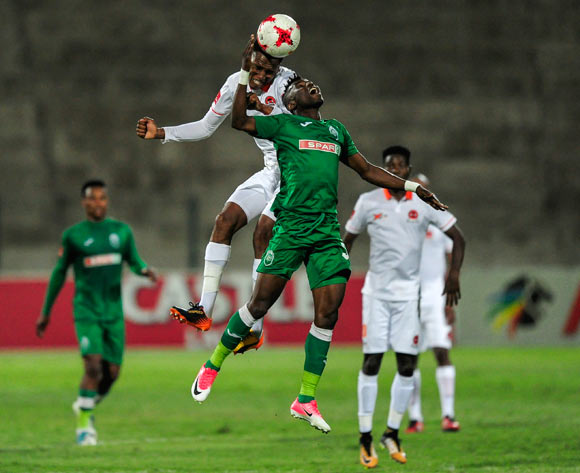 Sammy Seabi of Polokwane City FC gets to the ball before Samuel Mensah Darpoh of AmaZulu FC during the Absa Premiership 2017/18 game between AmaZulu and Polokwane City at King Goodwill Zwelithini Stadium, Durban on 18 October 2017 © Gerhard Duraan/BackpagePix