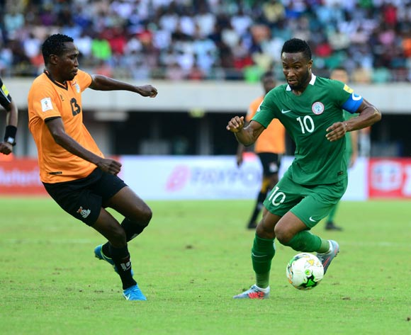Zunis Stopilla of Zambia challenges Obi Mikel of Nigeria during the 2018 FIFA World Cup qualifier football match between Nigeria and Zambia on 07 October 2017 at Godswill Akpabio Stadium, Uyo, Nigeria ©Kabiru Abubakar/BackpagePix