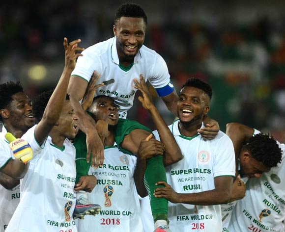 John Obi Mikel carried on shoulders of players Abdullahi Shehu, Kelechi Iheanacho and Chidozie Awaziem as Nigeria qualify for the World Cup during the 2018 FIFA World Cup qualifier football match between Nigeria and Zambia on 07 October 2017 at Godswill Akpabio Stadium, Uyo, Nigeria ©Kabiru Abubakar/BackpagePix