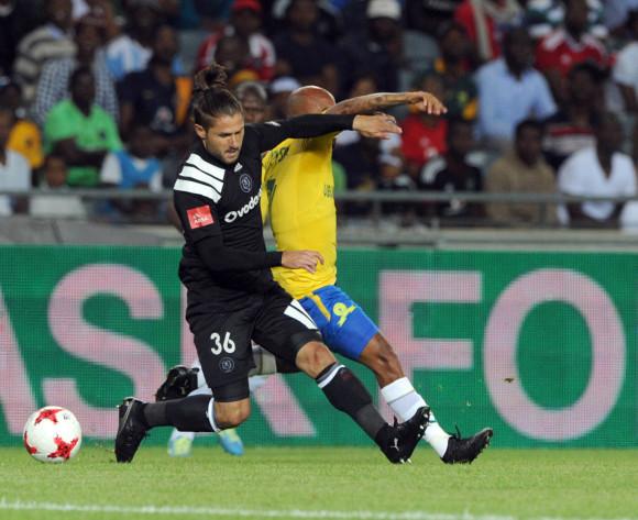 Marc van Heerden of Orlando Pirates is challenged by Oupa Manyisa of Mamelodi Sundowns during the Absa Premiership match between Orlando Pirates and Mamelodi Sundowns on 01 November 2017 at Orlando Stadium  @Sydney Mahlangu/BackpagePix
