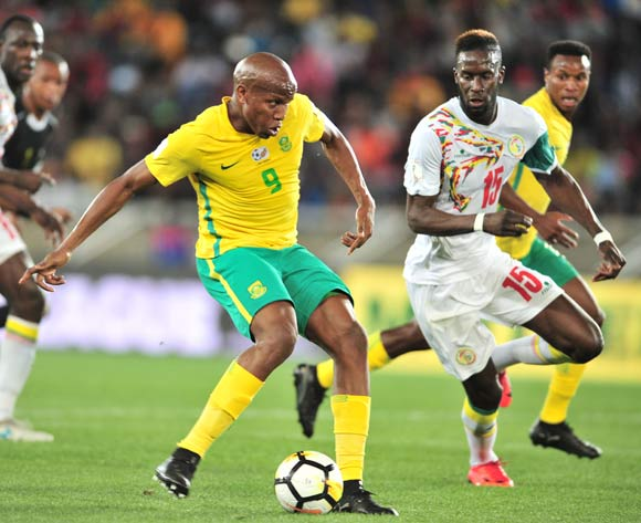 Lebogang Manyama of South Africa challenged by Salif Sane of Senegal during the 2018 World Cup Qualifiers football match between South Africa and Senegal at Peter Mokaba Stadium, Polokwane on 10 November 2017 ©Samuel Shivambu/BackpagePix