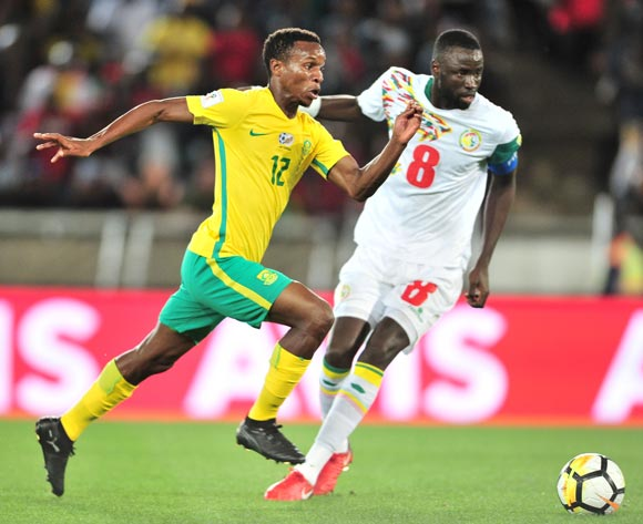 Themba Zwane of South Africa challenged by Cheikhou Kouyate of Senegal during the 2018 World Cup Qualifiers football match between South Africa and Senegal at Peter Mokaba Stadium, Polokwane on 10 November 2017 ©Samuel Shivambu/BackpagePix