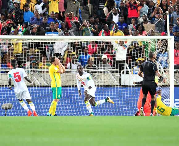 Sadio Mane of Senegal celebrates a goal with teammates and Dean Furman of South Africa reacts during the 2018 World Cup Qualifiers football match between South Africa and Senegal at Peter Mokaba Stadium, Polokwane on 10 November 2017 ©Samuel Shivambu/BackpagePix
