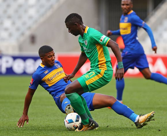 Robin Ngalande of Baroka FC tackled by Lyle Lakay of Cape Town City FC during the Absa Premiership 2017/18 football match between Cape Town City FC and Baroka FC at Cape Town Stadium, Cape Town on 21 November 2017 ©Chris Ricco/BackpagePix