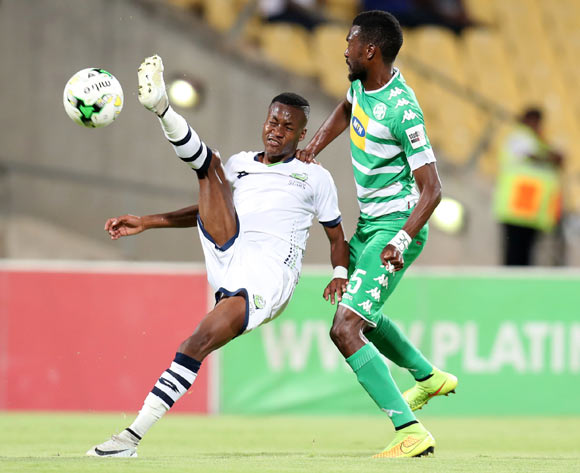 Katlego Otladisa of Platinum Stars clears ball from Lucky Baloyi of Bloemfontein Celtic during the Absa Premiership 2017/18 match between Platinum Stars and Bloemfontein Celtic at Royal Bafokeng Stadium, Rustenburg South Africa on 22 November 2017 ©Muzi Ntombela/BackpagePix
