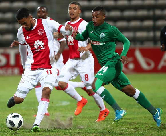 Tashreeq Morris of Ajax Cape Town evades challenge from Thembela Sikhakhane of AmaZulu during the Absa Premiership 2017/18 football match between Ajax Cape Town and AmaZulu at Athlone Stadium, Cape Town on 25 November 2017 ©Chris Ricco/BackpagePix