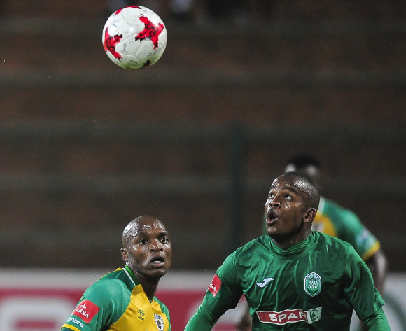Phumlani Gumede of AmaZulu FC has his eye firmly on the ball to clear it from Gift Motupa of Baroka FC during the Absa Premiership 2017/18 football match between AmaZulu FC and Baroka FC at King Goodwill Zwelentini Stadium, Durban on 01 November 2017 ©Gerald Duraan/BackpagePix