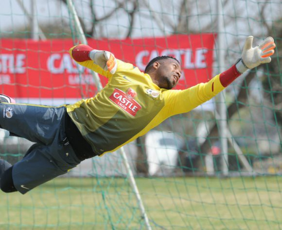 Injured Khune reports for national duty