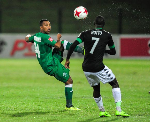Thembela Sikhakhane of AmaZulu FC lifts the ball over Deon Hotto of Bloemfontein Celtic during the Absa Premiership 2017/18 game between AmaZulu and Bloemfontein Celtic at King Zwelithini Stadium, Durban on 6 December 2017 © Gerhard Duraan/BackpagePix