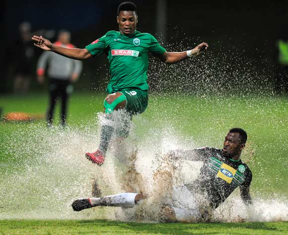 Alfred Ndengane of Bloemfontein Celtic slides in to defend the attacking Mhlengi Cele of AmaZulu FC the ball disappears in a spray of water during the Absa Premiership 2017/18 game between AmaZulu and Bloemfontein Celtic at King Zwelithini Stadium, Durban on 6 December 2017 © Gerhard Duraan/BackpagePix