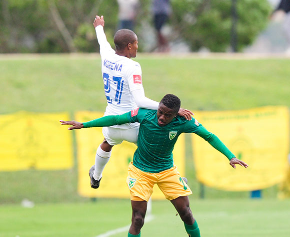 Thapelo Morena of Mamelodi Sundowns FC beats the race for the high ball with Siphelele Magubane of Lamontville Golden Arrows during the Absa Premiership 2017/18 game between Golden Arrows and Mamelodi Sundowns at Princess Magogo Stadium in Durban on 10 December 2017 © Gerhard Duraan/BackpagePix