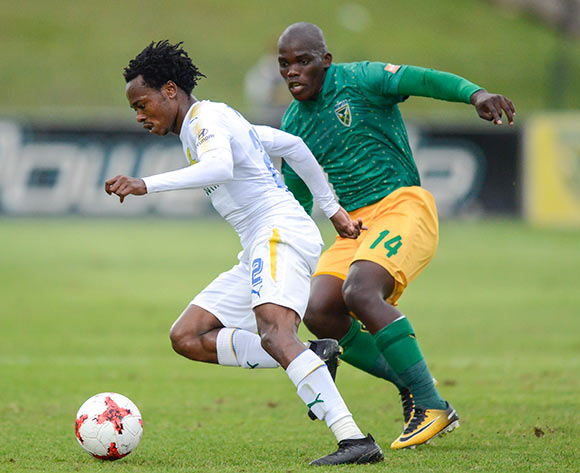 Siyabonga Dube of Lamontville Golden Arrows keeps an close eye on Percy Tau of Mamelodi Sundowns FC during the Absa Premiership 2017/18 game between Golden Arrows and Mamelodi Sundowns at Princess Magogo Stadium in Durban on 10 December 2017 © Gerhard Duraan/BackpagePix