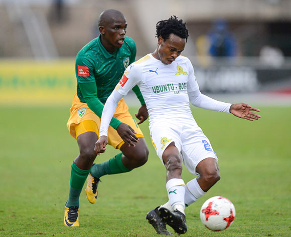 Siyabonga Dube of Lamontville Golden Arrows could not prevent Percy Tau of Mamelodi Sundowns FC of passing the ball during the Absa Premiership 2017/18 game between Golden Arrows and Mamelodi Sundowns at Princess Magogo Stadium in Durban on 10 December 2017 © Gerhard Duraan/BackpagePix