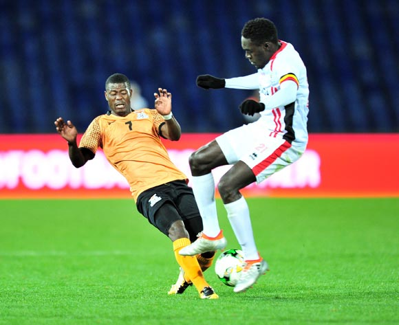 Ernest Mbewe of Zambia challenged by Timothy Dennis Awany of Uganda during the 2018 CHAN football game between Zambia and Uganda at the Grand Stadium in Marrakech, Morocco on 14 January 2017 ©Samuel Shivambu/BackpagePix