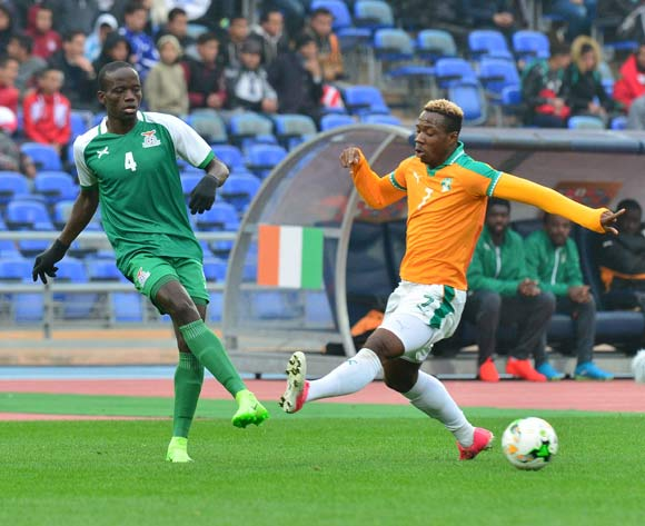 Adrian Chama of Zambia challenged by Mel William Togui of Ivory Coast during the 2018 CHAN football game between Ivory Coast and Zambia at the Grand stade Marrakech in Marrakech, Morocco on 18 January 2017 ©Samuel Shivambu/BackpagePix