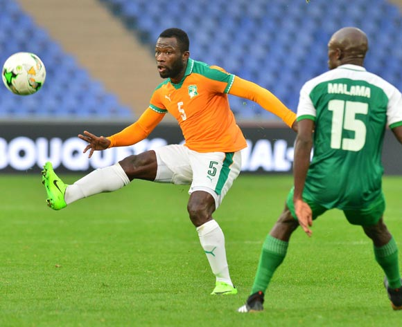 Essis Baudelaire Fulgence of Ivory Coast challenged by Donashano Malama of Zambia during the 2018 CHAN football game between Ivory Coast and Zambia at the Grand stade Marrakech in Marrakech, Morocco on 18 January 2017 ©Samuel Shivambu/BackpagePix