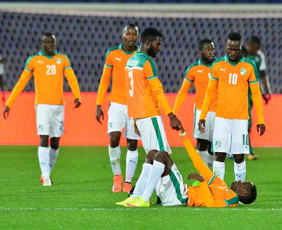 Wonlo Coulibaly dejected after the game help by Arnaud Wilfried Koutouan of Ivory Coast during the 2018 CHAN football game between Ivory Coast and Zambia at the Grand stade Marrakech in Marrakech, Morocco on 18 January 2017 ©Samuel Shivambu/BackpagePix
