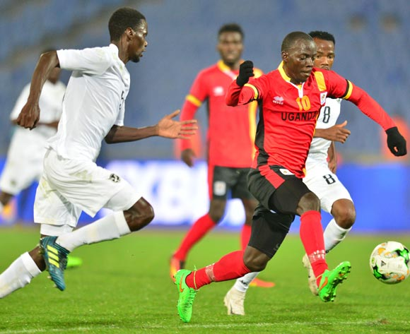 Muzamiru Mutyaba (c) of Uganda challenged by Ferdinand Epson Karongee (l) and Dynamo Carlos Fredericks (r) of Namibia during the 2018 CHAN football game between Uganda and Namibia at the Grand stade Marrakech in Marrakech, Morocco on 18 January 2017 ©Samuel Shivambu/BackpagePix