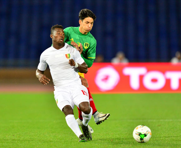 Ismael Sylla of Guinea challenged by Hemeya Tanjy of Mauritania during the 2018 CHAN football game between Mauritania and Guinea at the Grand stade Marrakech in Marrakech, Morocco on 21 January 2017 ©Samuel Shivambu/BackpagePix