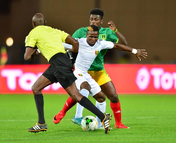 Daouda Bangoura of Guinea challenged by Alassane Diop of Mauritania during the 2018 CHAN football game between Mauritania and Guinea at the Grand stade Marrakech in Marrakech, Morocco on 21 January 2017 ©Samuel Shivambu/BackpagePix
