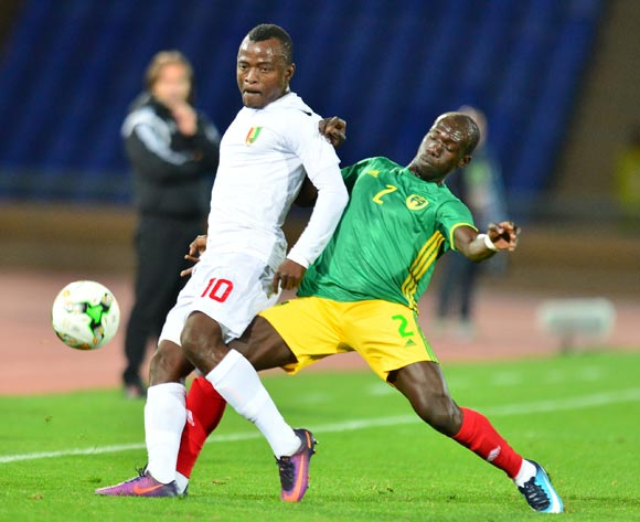 Saidouba Bissiri Camara of Guinea tackled by Mostapha Diaw of Mauritania during the 2018 CHAN football game between Mauritania and Guinea at the Grand stade Marrakech in Marrakech, Morocco on 21 January 2017 ©Samuel Shivambu/BackpagePix