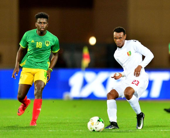 Mohamed Saliou Camara of Guinea challenged by Alassane Diop of Mauritania during the 2018 CHAN football game between Mauritania and Guinea at the Grand stade Marrakech in Marrakech, Morocco on 21 January 2017 ©Samuel Shivambu/BackpagePix