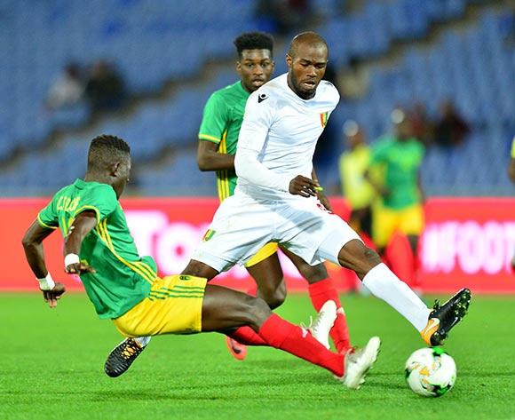 Aboubacar Camara of Guinea tackles by Demba Trawre of Mauritania during the 2018 CHAN football game between Mauritania and Guinea at the Grand stade Marrakech in Marrakech, Morocco on 21 January 2017 ©Samuel Shivambu/BackpagePix