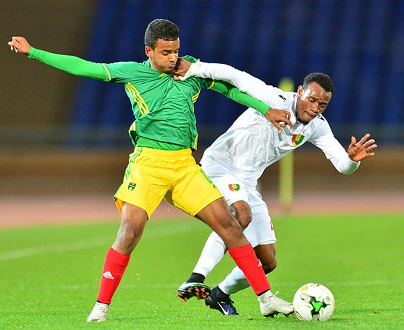 Hassen Teguedi of Mauritania challenged by Mohamed Saliou Camara of Guinea during the 2018 CHAN football game between Mauritania and Guinea at the Grand stade Marrakech in Marrakech, Morocco on 21 January 2017 ©Samuel Shivambu/BackpagePix
