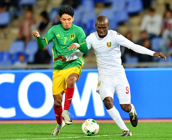 Hemeya Tanjy of Mauritania challenged by Aboubacar Camara of Guinea during the 2018 CHAN football game between Mauritania and Guinea at the Grand stade Marrakech in Marrakech, Morocco on 21 January 2017 ©Samuel Shivambu/BackpagePix