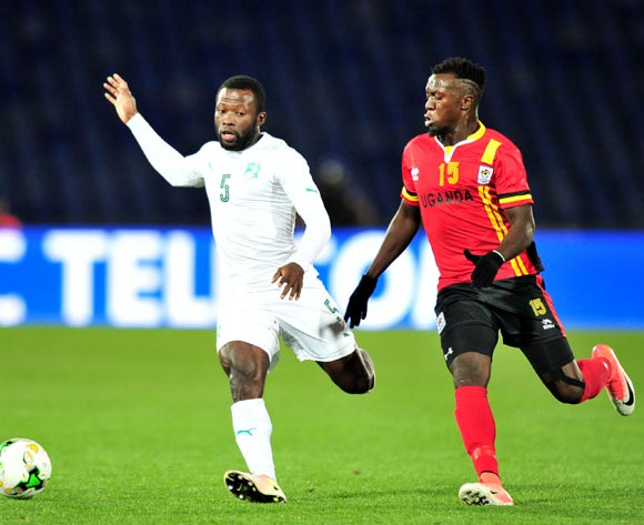 Essis Baudelaire Fulgence of Ivory Coast challenged by Juma Sadam Ibrahim of Uganda during the 2018 CHAN football game between Uganda and Ivory Coast at the Grand stade Marrakech in Marrakech, Morocco on 22 January 2017 ©Samuel Shivambu/BackpagePix