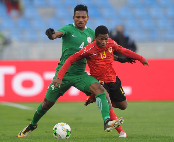 Emeka Francis Atuloma of Nigeria challenges Vladimir Etson Va of Angola during the ACHAN Quarterfinal match between Nigeria and Angola on 28 January 2018 at  Grand Stade de Tanger, Tanger,  Morocco Pic Sydney Mahlangu/BackpagePix