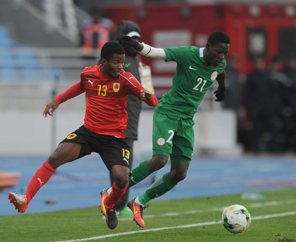Sunday Adeyemi Faleye of Nigeria is challenged by Vladimir Etson Va of Angola during the ACHAN Quarterfinal match between Nigeria and Angola on 28 January 2018 at  Grand Stade de Tanger, Tanger,  Morocco Pic Sydney Mahlangu/BackpagePix