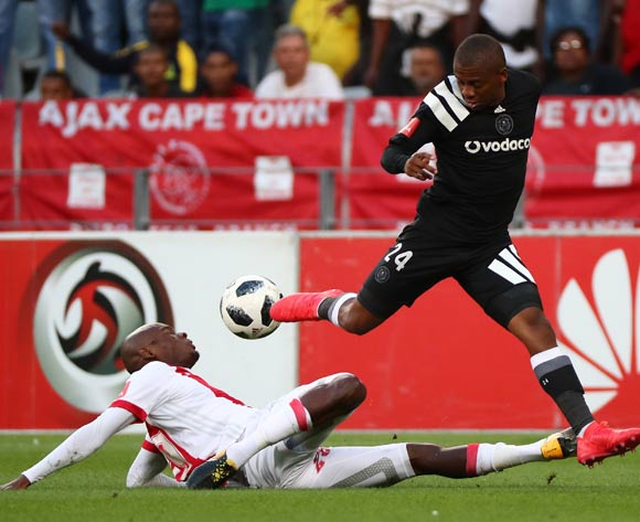 Thabiso Kutumela of Orlando Pirates tackled by Siyanda Zwane of Ajax Cape Town during the Absa Premiership 2017/18 football match between Ajax Cape Town and Orlando Pirates at Cape Town Stadium, Cape Town on 31 January 2018 ©Chris Ricco/BackpagePix