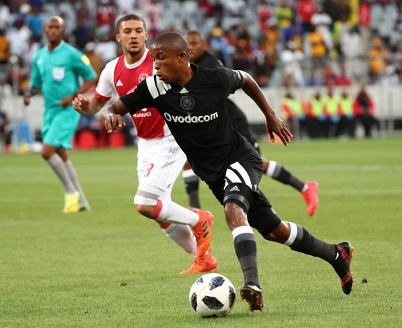 Luvuyo Memela of Orlando Pirates gets away from Grant Margeman of Ajax Cape Town during the Absa Premiership 2017/18 football match between Ajax Cape Town and Orlando Pirates at Cape Town Stadium, Cape Town on 31 January 2018 ©Chris Ricco/BackpagePix