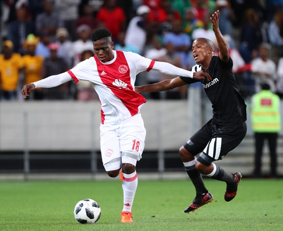 Grant Margeman of Ajax Cape Town battles for the ball with Luvuyo Memela of Orlando Pirates during the Absa Premiership 2017/18 football match between Ajax Cape Town and Orlando Pirates at Cape Town Stadium, Cape Town on 31 January 2018 ©Chris Ricco/BackpagePix