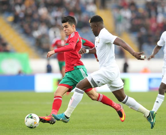 Achraf Bencharki of Morocco challenged by Ahmed Mohamed Al Maghasi of Libya during the 2018 Chan semifinal football match between Morocco and Libya at Stade Mohammed in Casablanca, Morocco on 31 January 2018 ©Gavin Barker/BackpagePix